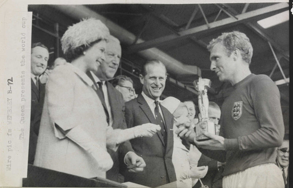 The_Queen_presents_the_1966_World_Cup_to_England_Captain,_Bobby_Moore._(7936243534)