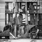 Louise Nevelson's Sky Covenant, 1973, during fabrication at the shop. The interiors of the boxes were made individually, and the boxes were bolted together to assemble the completed sculpture. The worker at the lower left is grinding the edges of one of the interior components, so they fit together properly.