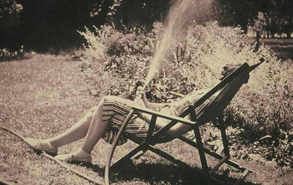 Welty watering in her garden.