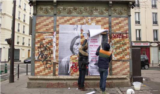 JR (right) and collaborator, 11th arrondissement, Paris.