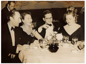 "Sonia Orwell dining with (left to right) John Halas, Joy Batchelor and Bordon Mace, president of the company which produced the 1954 educational film, ""Ani-mal Farm."""