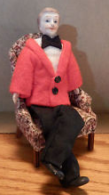 Man doll in particularly ridiculous-looking red jacket.