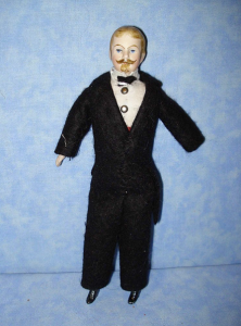 Man doll in typically ill-fitting suit.
