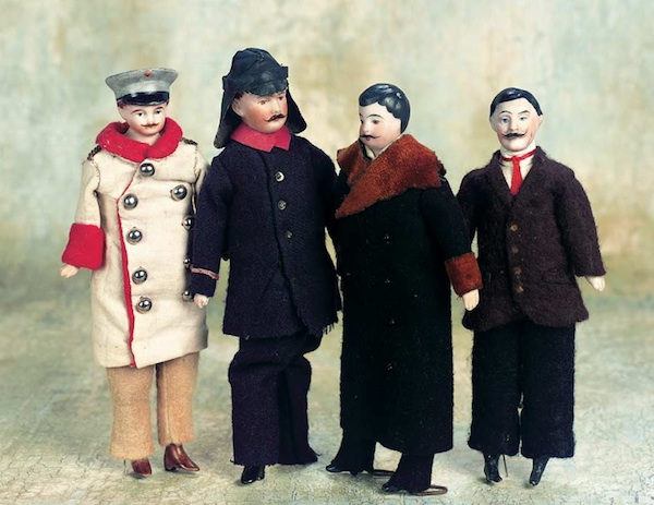 Male dolls in a range of ill-fitting costumes.