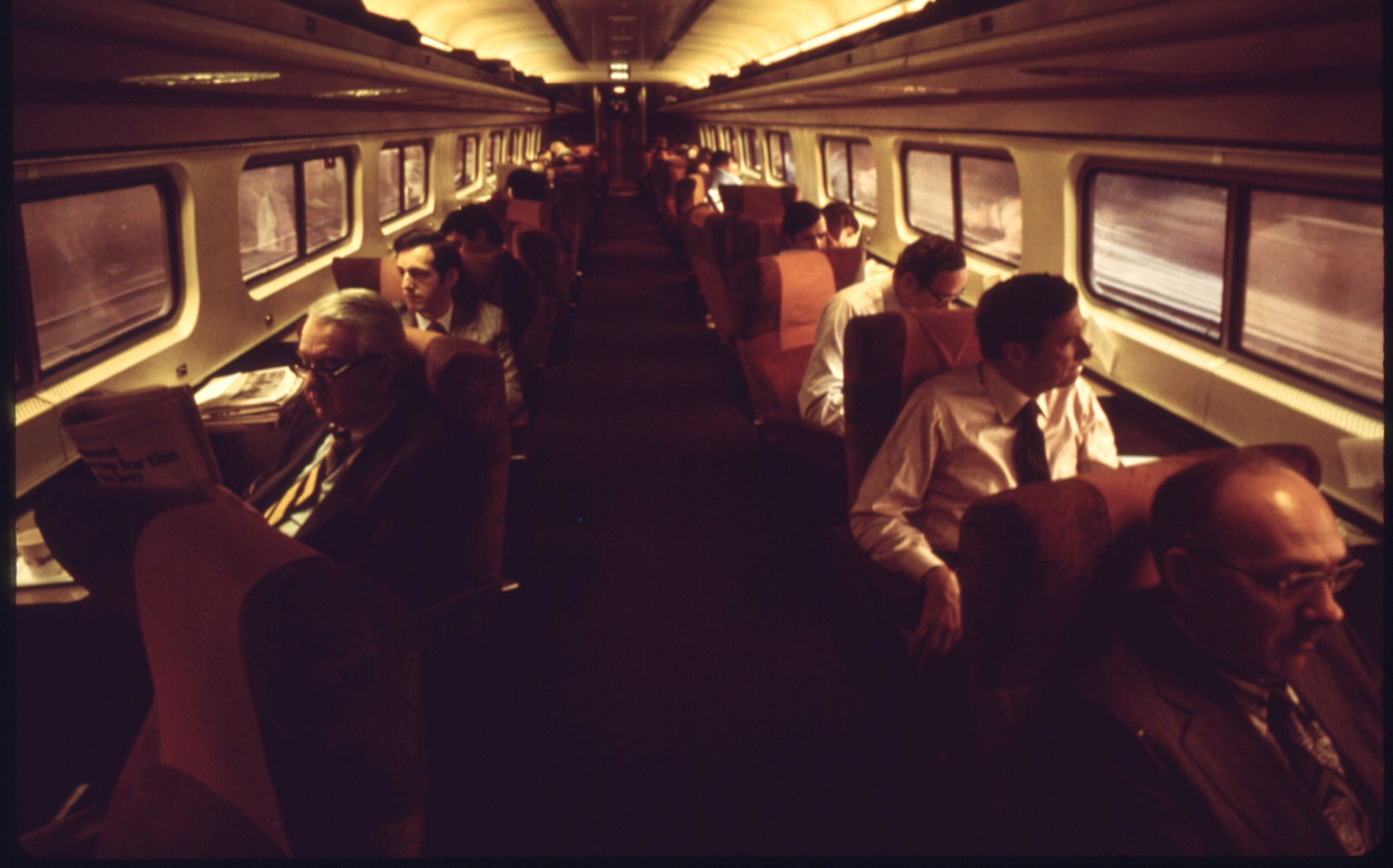 PASSENGERS_ON_ONE_OF_THE_AMTRAK_METROLINER_TRAINS_WHICH_RUN_BETWEEN_WASHINGTON,_DISTRICT_OF_COLUMBIA,_AND_NEW_YORK..._-_NARA_-_556656