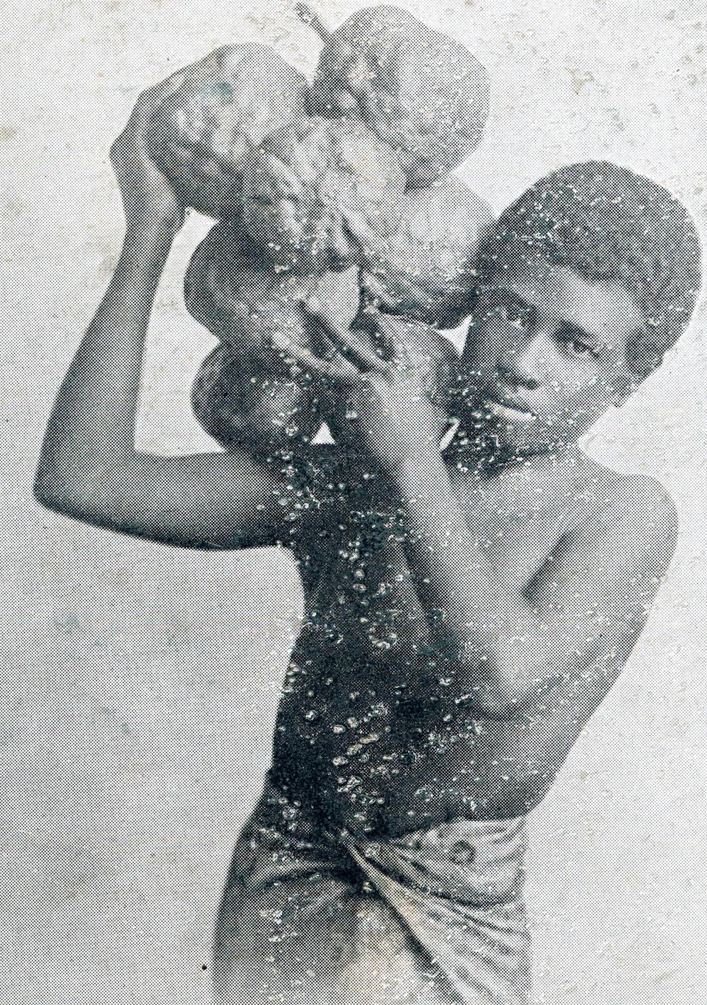 Young_man_carrying_fruit_of_a_breadfruit_tree,_Fiji,_ca.1900-1930