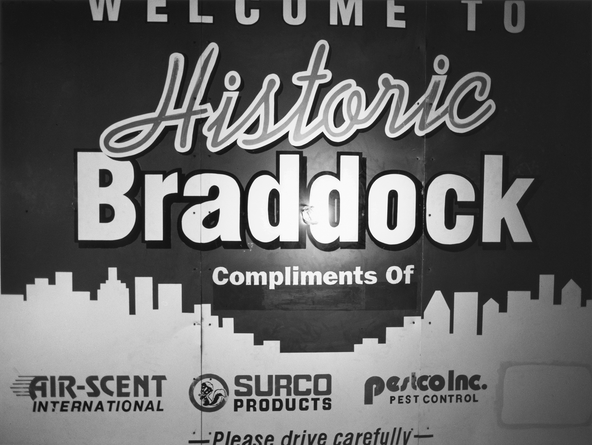 "LaToya Ruby Frazier,1980s ""Welcome to Historic Braddock"" Signage and a Lightbulb, 2009, from The Notion of Family (Aperture, 2014)"