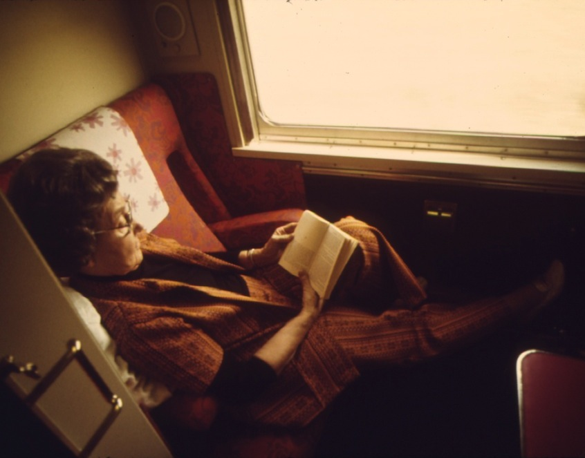 A_PASSENGER_ON_THE_LONE_STAR_PASSES_THE_TIME_READING_IN_HER_COMPARTMENT_AS_THE_TRAIN_CROSSES_OKLAHOMA_ENROUTE_FROM..._-_NARA_-_556033