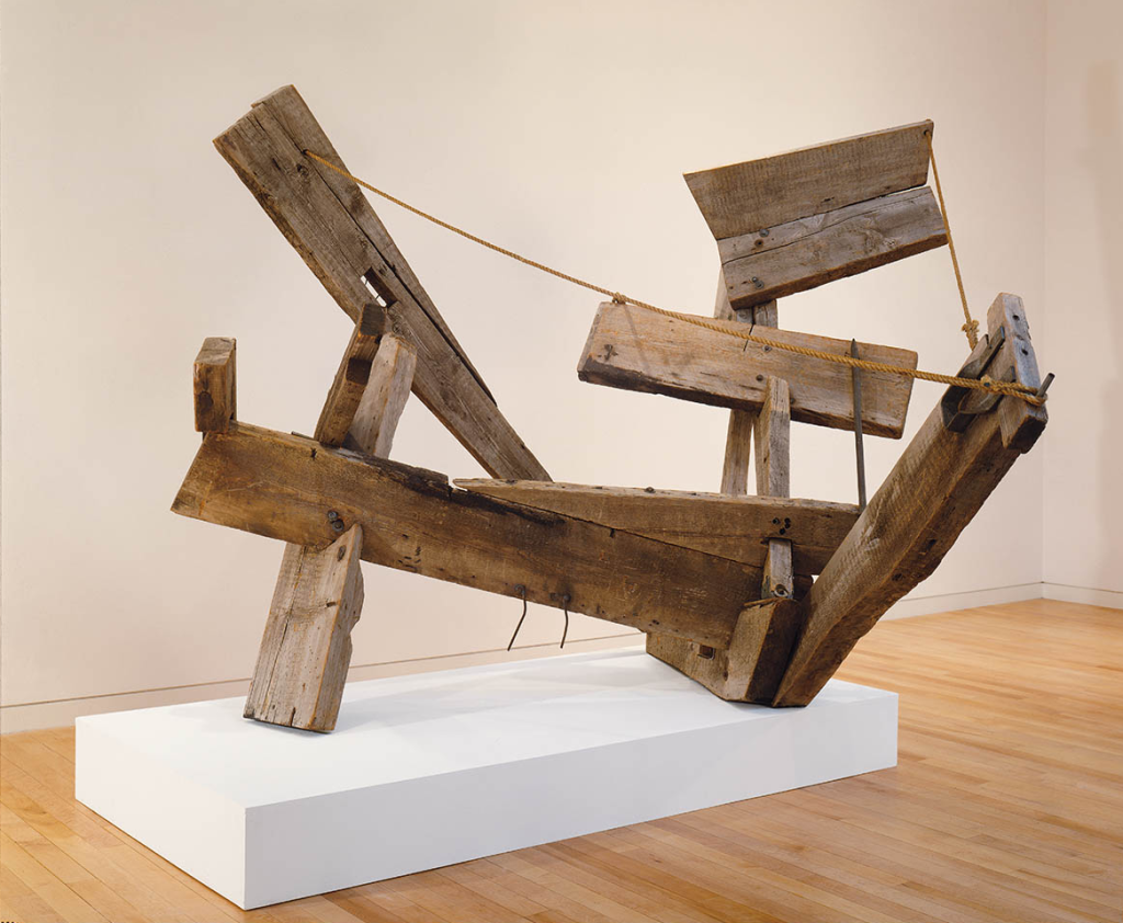 """Mark di Suvero, Che Faró Senza Eurydice, 1959. Weathered timber, rope, and nails, 84"""" x 8' 8"""" x 91"""", Doris and Donald Fisher Collection. Photo: Ali Elai"""