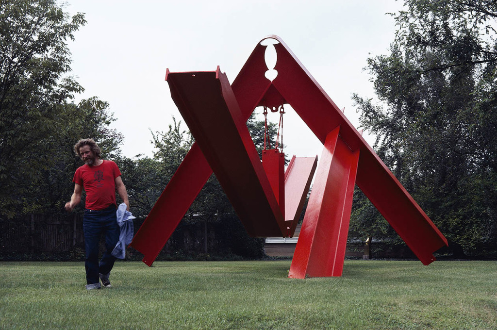 Mark di Suvero, photographed in St. Louis, Missouri, 1981, with his sculpture For Rilke, 1975-76, steel, 18 x 40 x 20', Private Collection, St. Louis, Missouri. Photo: ©George Bellamy