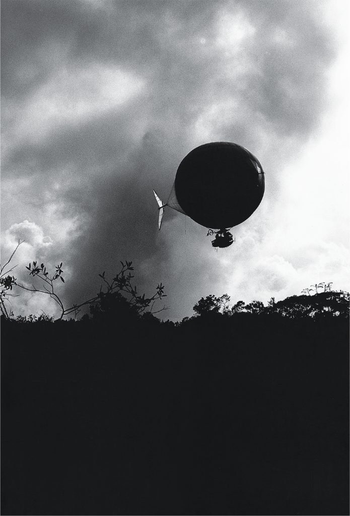 Lena Herzog, Airship flying out of a storm, 2004.
